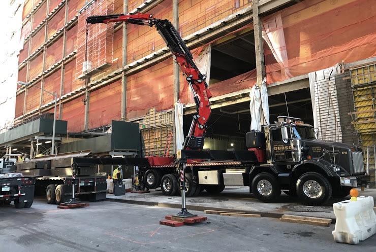 durso knuckleboom truck offloading at jobsite