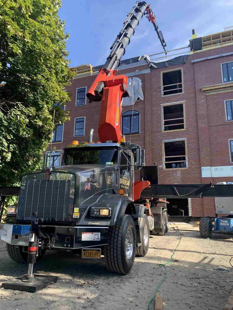 durso knuckleboom truck at job site