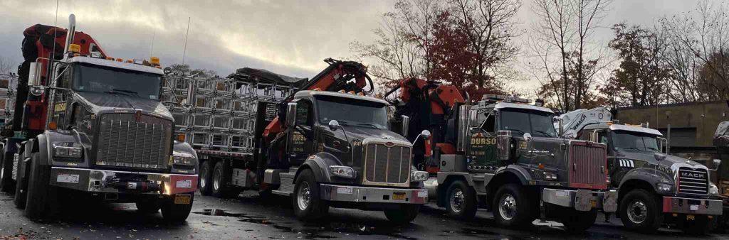 durso knuckleboom trucks parked in yard